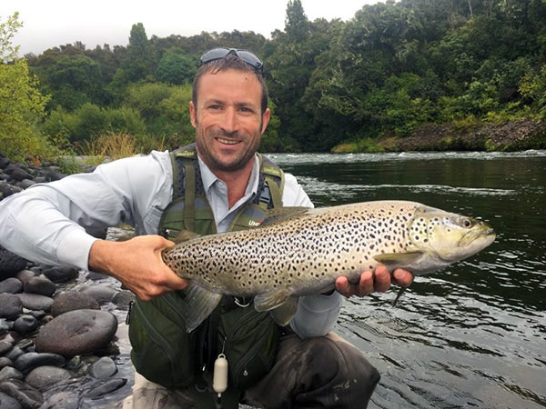 Aidan Wildley holding a Tongariro river Brown Trout